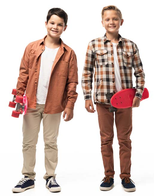 Retro image of two teen boys with skateboards