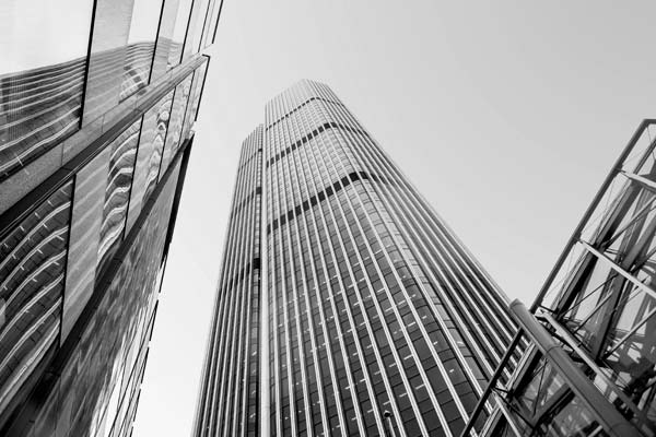 Image of high rise office buildings from below looking up